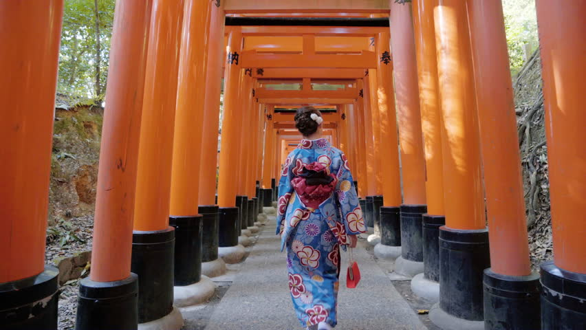 Asian women in traditional japanese kimonos walking at Fushimi Inari Shrine in Kyoto, Japan. 4K | Shutterstock HD Video #1014415637