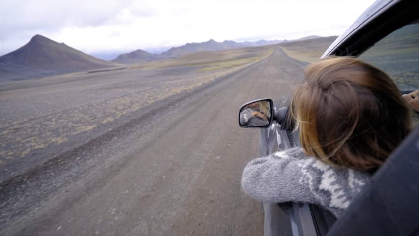 Woman driving car looks out of vehicle window. Freedom on the road, road trip concept young woman driving  | Shutterstock HD Video #1014428207