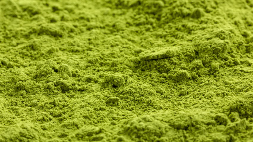 Matcha green tea ground full frame on flat background, elevated front view | Shutterstock HD Video #1014447017