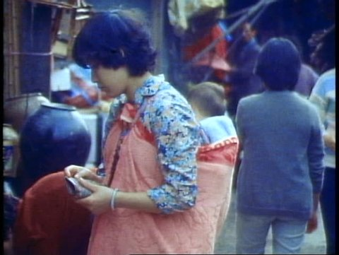 HONG KONG, CHINA, 1982, Young Chinese woman with a baby on her back