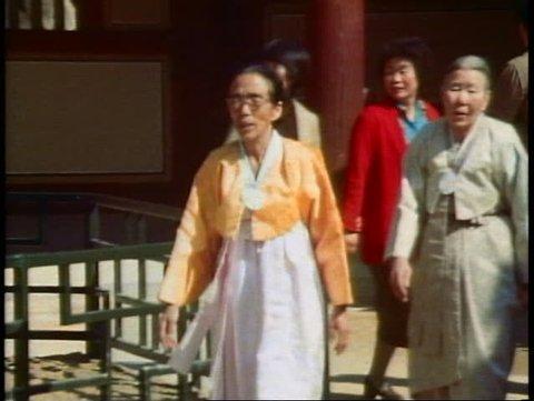 PUSAN, SOUTH KOREA, 1982, Buddha Land Temple, women walks through courtyard