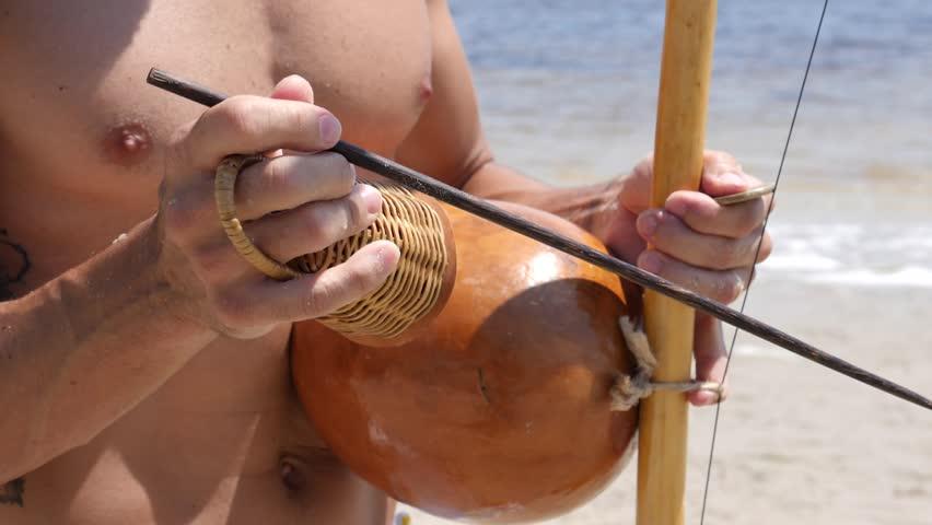 Brazilian culture Capoeira  Musicians Play Brazilian Musical Instruments Artist Playing Berimbau Tambourine Or Pandeiro