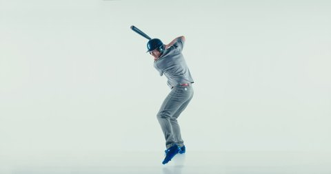 Caucasian professional baseball player batter wearing generic uniform posing as if he was hitting a ball isolated on white background. 4K UHD 60 FPS SLOW MOTION