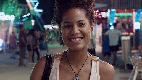 Portrait of woman smiling at funfair.