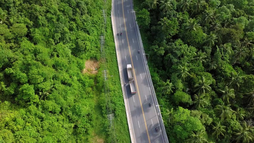 Aerial View of Transport Moving along Road on Tropical Island in Thailand #1014569597
