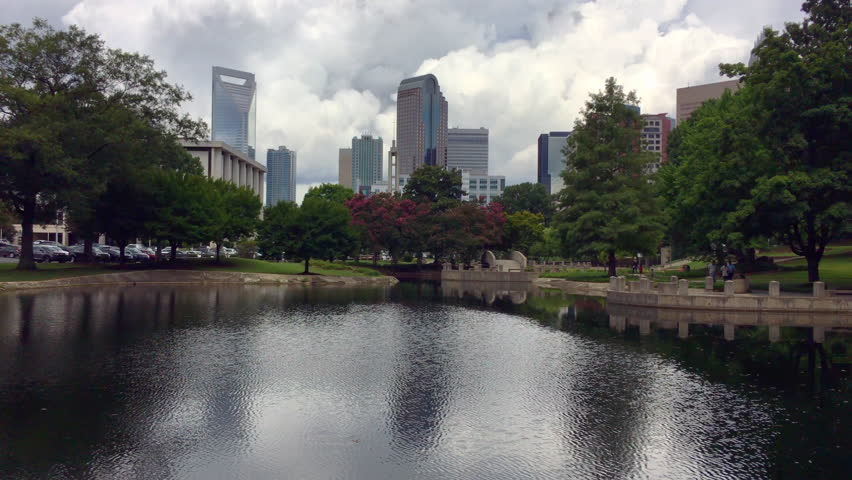 Charlotte NC skyline as seen from Marshall Park on a cloudy summer day
