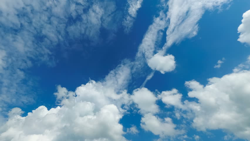 Layered Clouds are Moving in the Blue Sky. Time Lapse. Beautiful White fluffy clouds over blue sky soar in Timelapse. | Shutterstock HD Video #1014611657