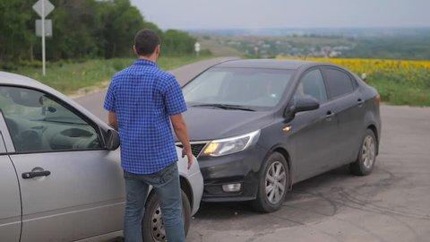 Two men arguing conflict after a car accident on the road car insurance. slow motion video. Two Drivers man Arguing After Traffic Accident lifestyle. auto insurance accident concept men