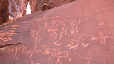 Example of petroglyphs rock carvings made by pecking directly on the rock surface using a stone chisel and a hammerstone.