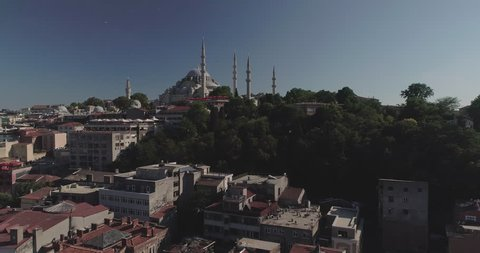 A captivating 4k aerial flight from Halic Bridge to Suleymaniye Kulliyesi Mosque. Istanbul. Turkey. The Halic Bridge, Golden Horn Bridge, is a highway bridge on theGolden HorninIstanbul.Turkey.