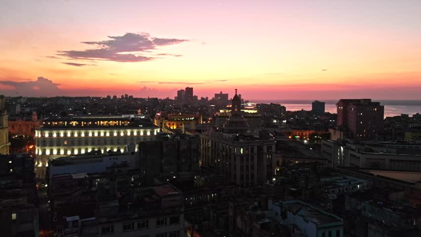 Cuba Havana v13 Flying low over Old Havana toward water view at dusk 4/18