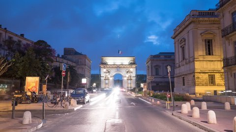 Montpellier, France - May, 2017: Timelapse of the Foch street and Porte Du Peyrou, at dusk.
