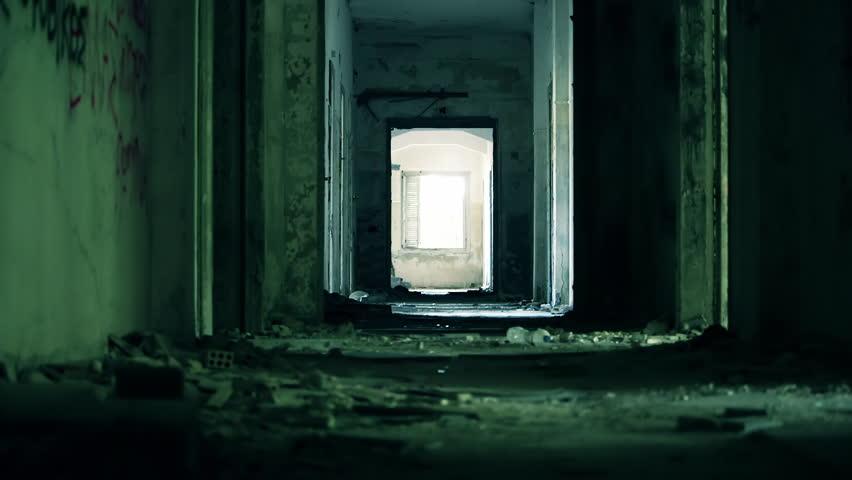 Abandoned long corridor/hallway,dolly slider motion.A long corridor/hallway of a destroyed by an earthquake and evacuated hotel.