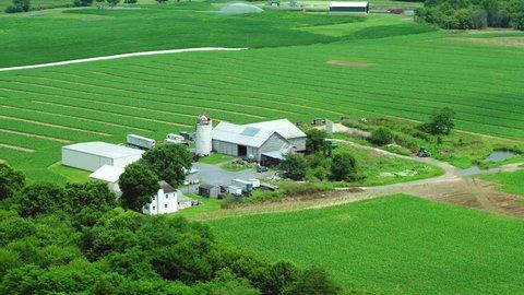 Aerial farm on farmland tracking shot