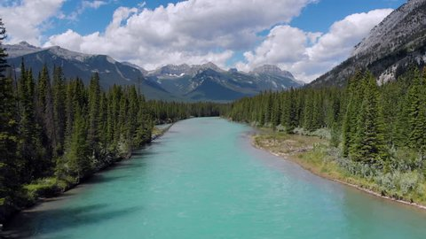 Banff National Park aerial view, flying over the Bow River in the Canadian Rockies during summer, Alberta, Canada.