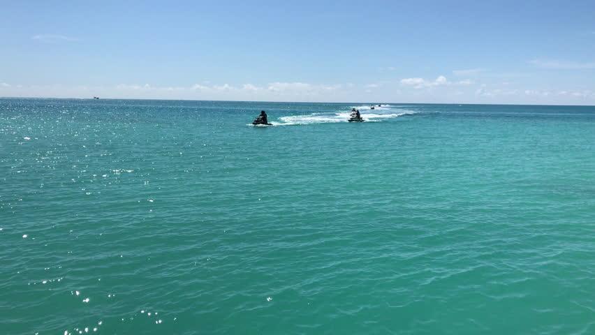 Jet skis in line on turqoise ocean, Bermuda | Shutterstock HD Video #1014798617