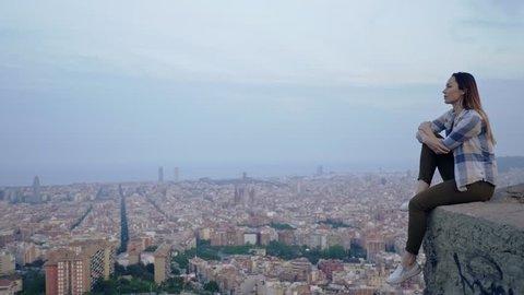 Beautiful woman enjoying Barcelona city view from Bunkers del Carmel, Spain