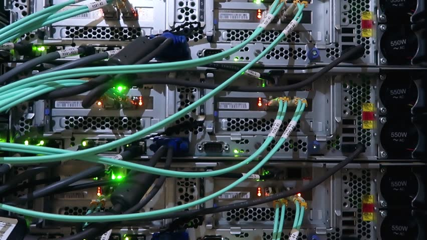 Back panel of powerful servers installed in the rack of the server room of the data center | Shutterstock HD Video #1014876427