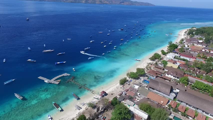 Beach panorama at Gili Trawangan with blue sky, palm trees and turquoise water | Shutterstock HD Video #1014931717