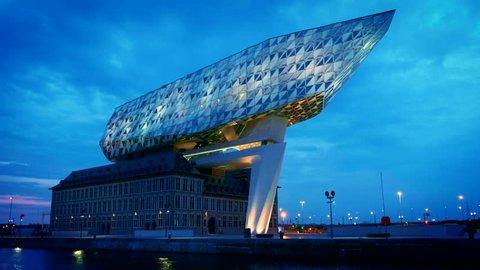 ANTWERP, BELGIUM - MAY 27, 2018: Antwerp port administration headquarters, designed by famous iranian architect Zaha Hadid, Antwerpen, Belgium illuminated at night