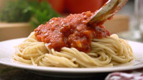 Eating spaghetti with marinara or tomato sauce, Italian cuisine.