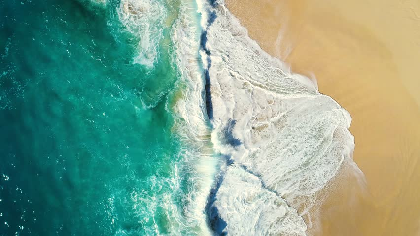 Aerial view waves break on white sand beach. Sea waves on the beautiful beach. drone 4k shot. zoom in	 | Shutterstock HD Video #1015024837