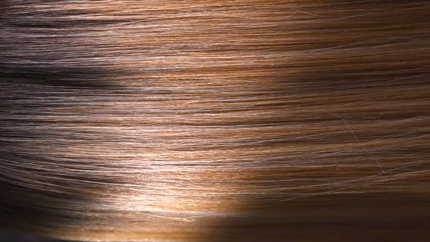 Hair. Beautiful healthy long smooth flowing brown hair close-up texture. Dyed straight hair background, coloring, extensions, cure, treatment concept. Haircare. Slow motion 4K UHD video