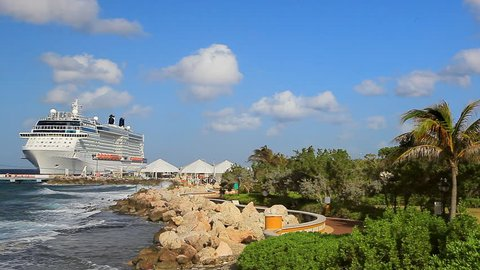 Cruise Ship in port on Caribbean island on sunny day