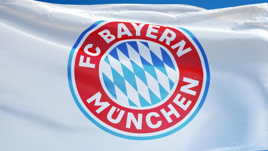 500ba86060d ... GERMANY MUNICH JULY 2018  FC Bayern Munich flag waving in slow motion  against blue sky ...