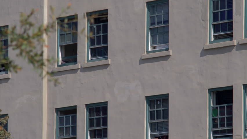 GENERIC WORN OUT APARTMENT WINDOWS.  ESTABLISHING SHOT IN 4K, 10 bit.