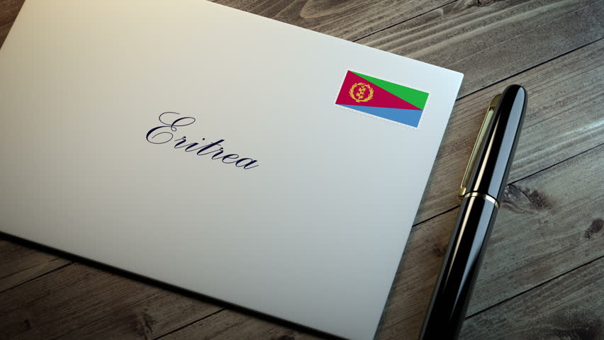 Country name written on a card or envelope in cursive font with a sleek pen on a wooden table surface under beautiful classy light. Stamp in the corner shows the flag of Eritrea