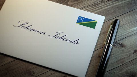 Country name written on a card or envelope in cursive font with a sleek pen on a wooden table surface under beautiful classy light. Stamp in the corner shows the flag of Solomon Islands