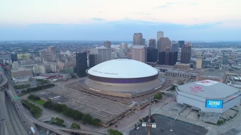 NEW ORLEANS, LOUISIANA, USA - AUGUST 1, 2018: Aerial hyperlapse orbit sports arena Mercedes Benz Superdome New Orleans