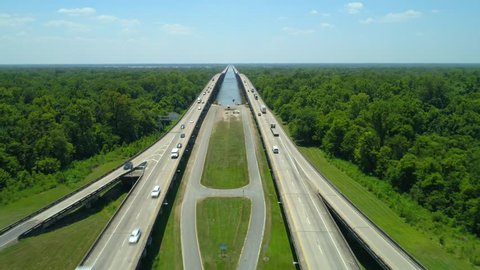 Aerial drone video of I10 over the Atchafalaya River and nature preserve Louisiana USA 4k