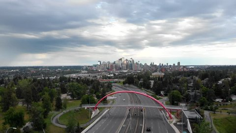 Calgary, Alberta, Canada, aerial view of traffic on highway with Downtown buildings in the background during daytime.