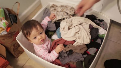 Funny Baby Hiding in Laundry Basket