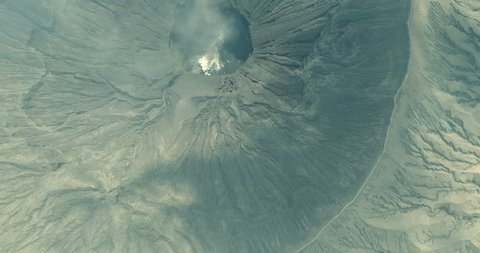Mount Bromo volcanic crater smoke emission an aerial view, Indonesia
