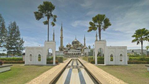 Time-lapse of beautiful mosque at Kuala Terengganu, Malaysia. Famous building and islamic design mosque in Malaysia. Beautiful landscape of Masjid Kristal, Kuala Terengganu in hot sunny day.