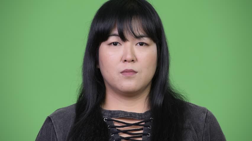 Head shot of beautiful overweight Asian woman | Shutterstock HD Video #1015376347
