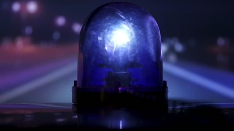 Vehicle with blue flash emergency light on highway at night time-lapse