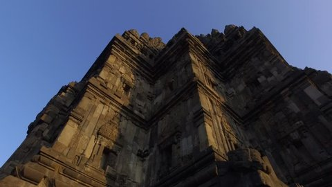Beautiful cinematic shot of Prambanan Temple with sun rising behind the temple and stupa