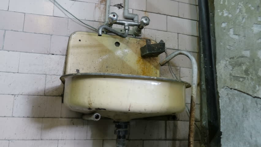 The dusty, rusty sink. Old metal sink