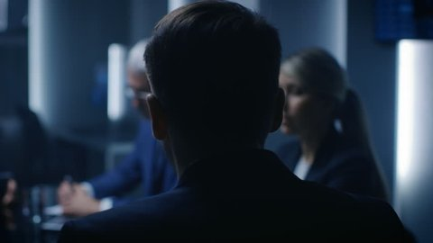 Chief Strategy Officer Making Report to a Board of Directors During Annual Financial Meeting in the conference Room. Business People / Politicians / Government Officials. Shot on RED EPIC-W 8K Camera.