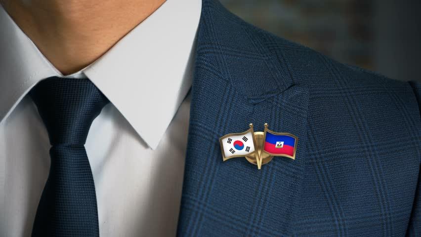 Businessman Walking Towards Camera With Friend Country Flags Pin South Korea - Haiti
