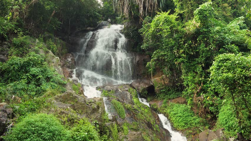 Wide establishing shot of Na Mueang Waterfall in Koh Samui Thailand