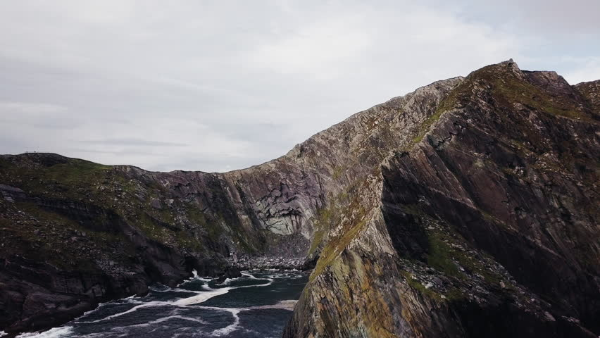 Cinematic drone footage of the Cliffs of Kerry in the Ring of Kerry in Ireland.   Shutterstock HD Video #1015423687