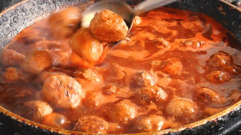 Fresh made Meatballs with tomato sauce. Cooking meatballs