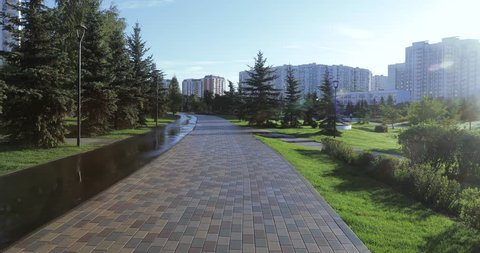 In the city landscape children's park of South Butovo, a bicycle and a running track among beautiful spruces