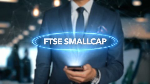 Businessman With Mobile Phone Opens Hologram HUD Interface and Touches Word - FTSE SMALLCAP