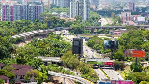 hot day Time-Lapse road traffic in Kuala Lumpur. pan up